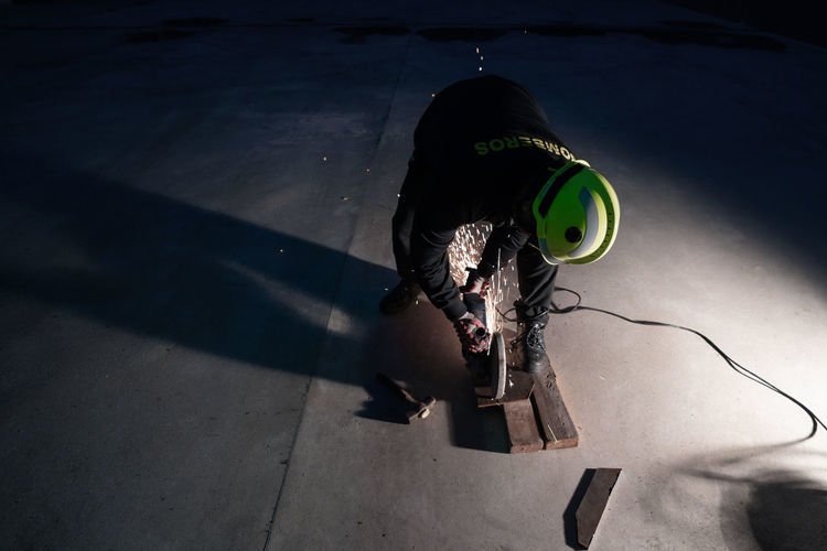 High angle view of woman with toy on floor