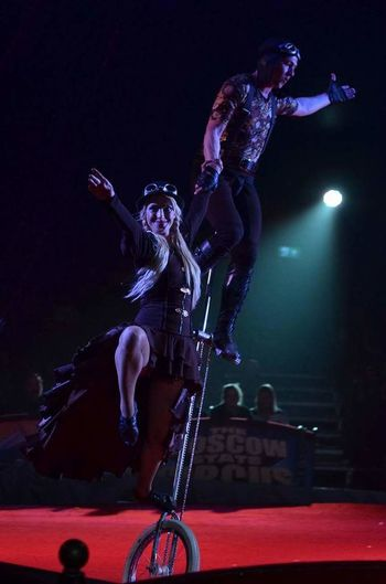 Performance Arts Culture And Entertainment Full Length Night Skill  Performing Arts Event Sport Lifestyles People Music Stunt Adult Acrobat Flexibility Adults Only Indoors  One Person Rock Music Musician Athlete Bike Unicycle Unicycle Tricks Moscow State Circus Skill