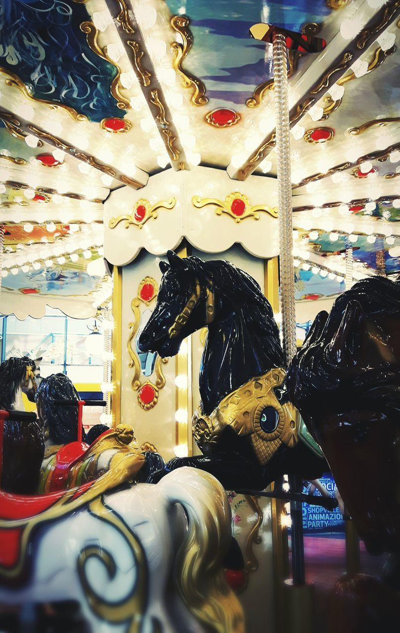animal representation, amusement park, amusement park ride, hanging, arts culture and entertainment, carousel, carousel horses, retail, variation, multi colored, store, indoors, no people, market, day, close-up, animal themes