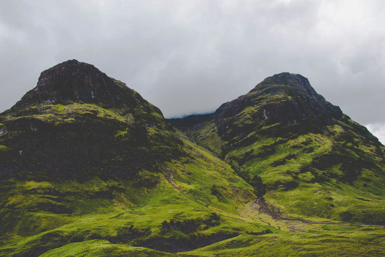 Glencoe Grass Scotland Beauty In Nature Cloud - Sky Clouds Day Environment Geology Green Color Idyllic Landscape Mountain Mountain Peak Mountain Range Nature No People Non-urban Scene Outdoors Plant Scenics - Nature Sky Tranquil Scene Tranquility
