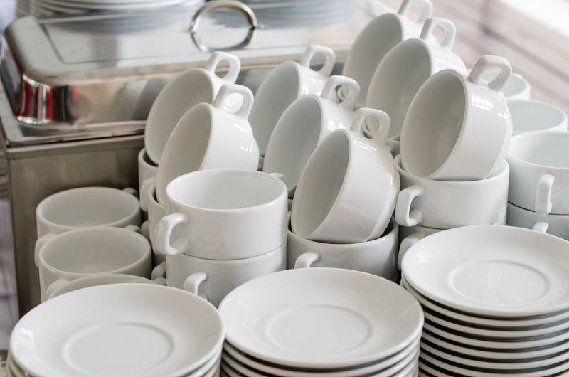 Close-up of crockery arranged on buffet table in restaurant