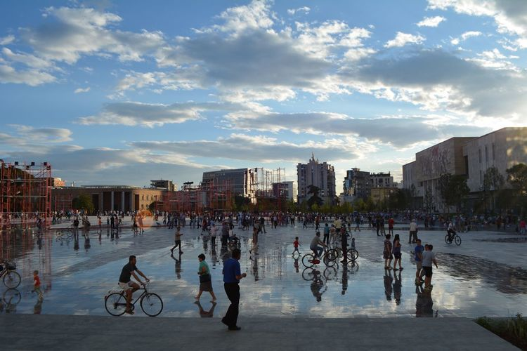 Main Square transformation Hometown Love Scanderbeg Summer Views Architecture Bicycle Building Exterior Built Structure City City Life Cloud - Sky Day Large Group Of People Main Square Men Outdoors People Real People Sky Sunlight Transformation Transportation Stories From The City Summer Exploratorium Adventures In The City Focus On The Story The Street Photographer - 2018 EyeEm Awards