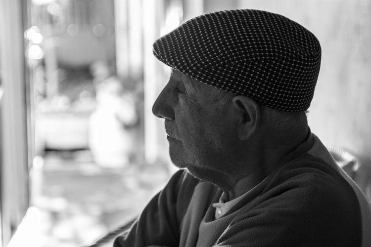 Close-up of senior man wearing flat cap