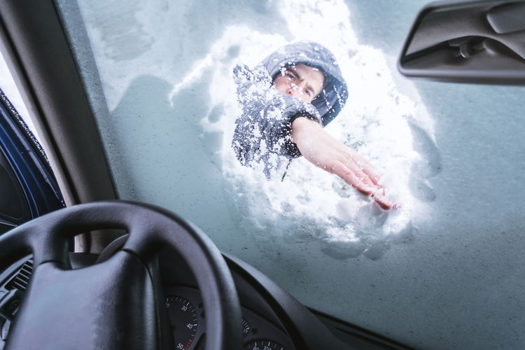 Man outdoor cleaning snow on his car from inside of car. Car Child Childhood Day High Angle View Hygiene Indoors  Innocence Men Mode Of Transportation Motion Motor Vehicle Nature One Person Real People Transportation Vehicle Interior Water
