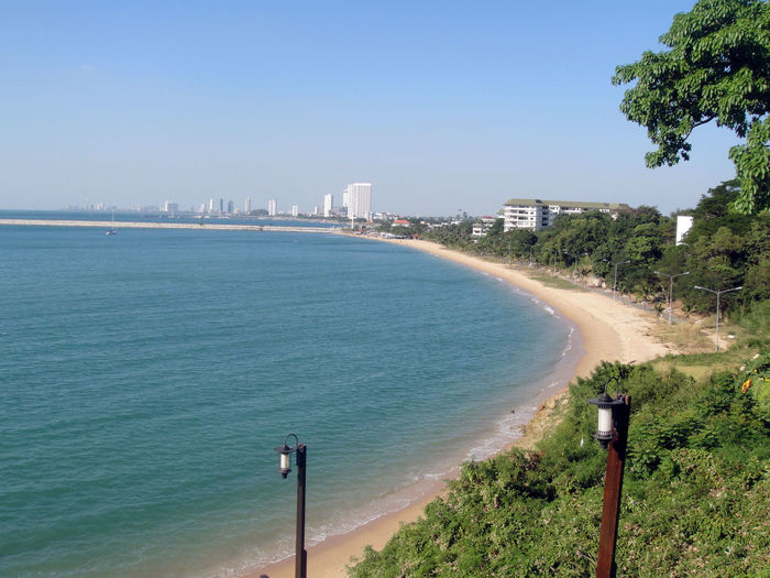At Pattaya Beach Beaches Beatiful Beautiful Sea View Building Hotels I Want To Sea I Want To Walk Alone Lamp Posts Lamps Lighting Seaside Ocean Sea Bright Seashore Seaside Trees And Sky Treescape We Can To Sea