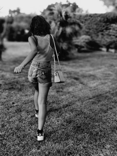 Tutto d'un fiato. The Great Outdoors - 2018 EyeEm Awards Full Length Child Childhood Women Rear View Long Hair Grass
