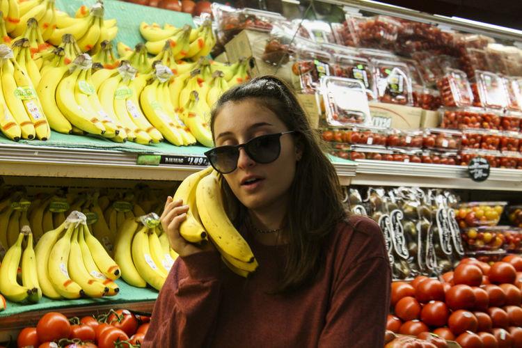 Woman wearing sunglasses at market stall