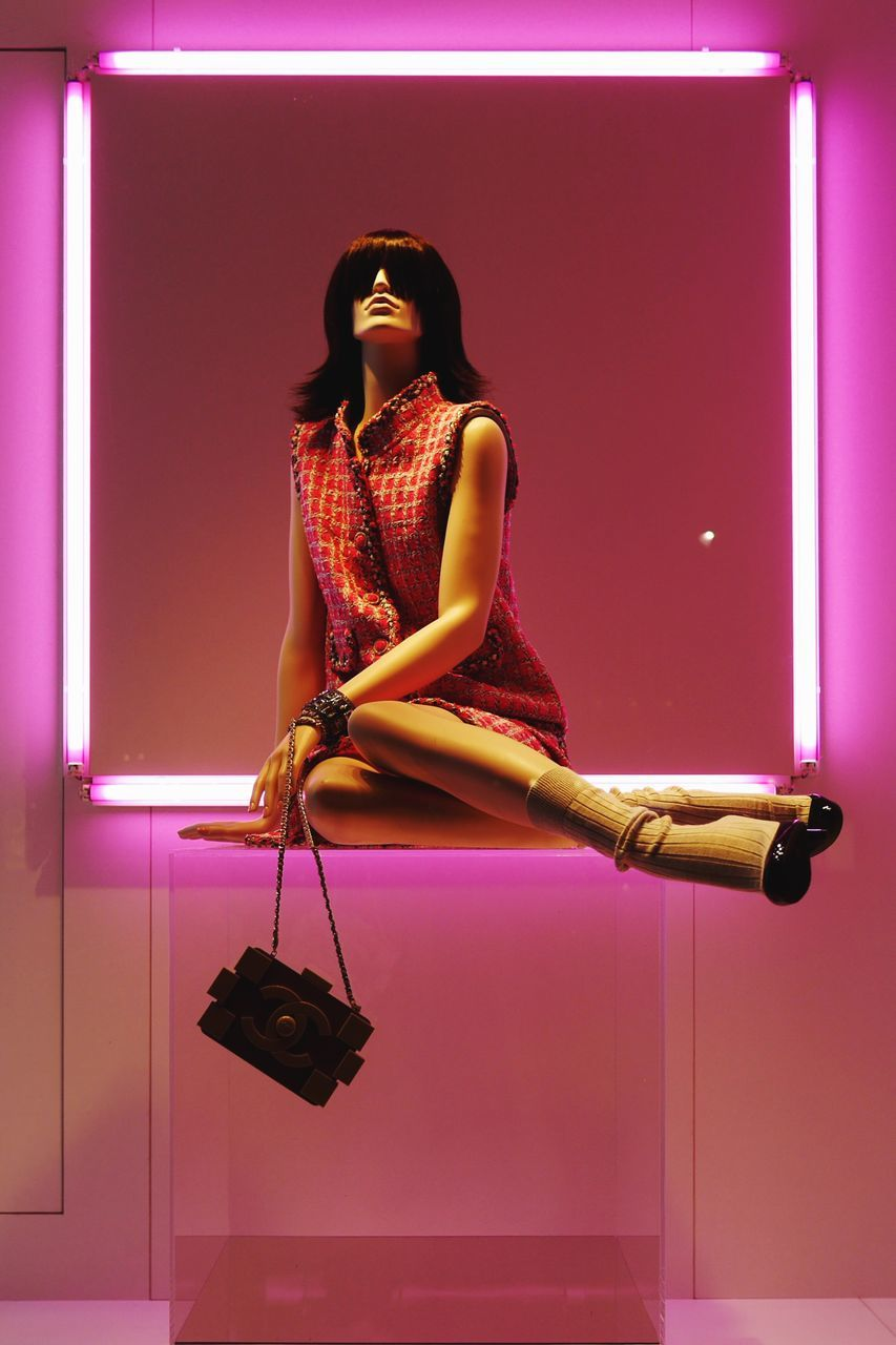 fashion, illuminated, pink color, full length, one person, glamour, lifestyles, indoors, beautiful woman, night, young adult