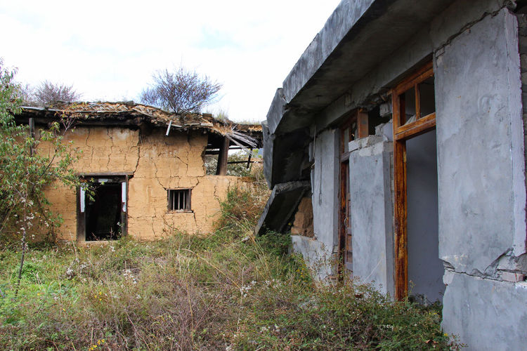 Houses damaged by the 2008 Sichuan Earthquake 2008 2008 Sichuan Earthquake Abandoned Architecture Building Exterior Built Structure China Damaged Day Earthquake Grass House Natural Disaster No People Open Door Outdoors Sichuan Sichuan Earthquake Sky Tree Weathered Window