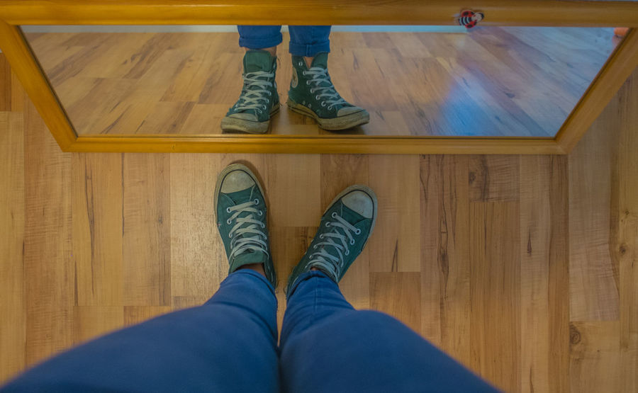 Blue Casual Clothing Close-up Directly Above Flooring Hardwood Floor High Angle View Human Body Part Human Foot Human Leg Indoors  Leisure Activity Lifestyles Low Section Out Of The Box Personal Perspective Real People Shoe Shoes Standing Wooden Floor