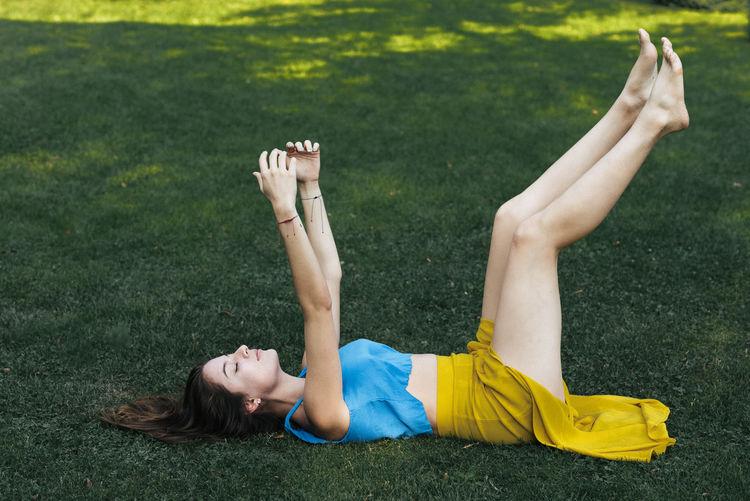 Full length of woman lying on grass