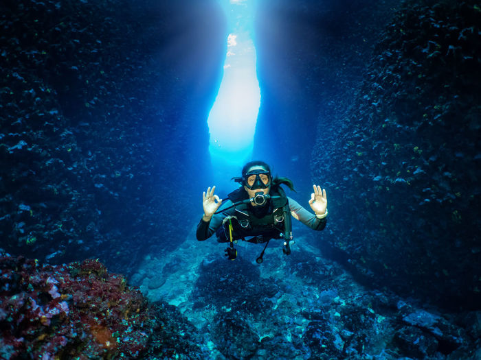 Portrait of woman scuba diving in sea