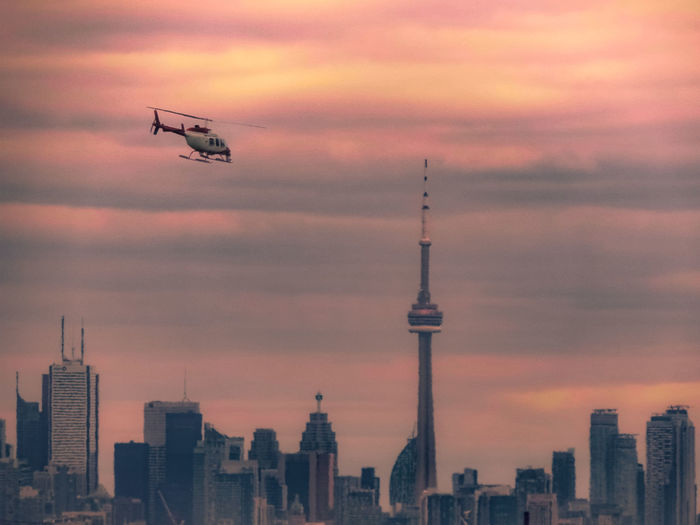 CP24 Helicopter Heading Towards Toronto At Sunset Check This Out Exceptional Photographs EyeEm Best Shots Hanging Out Helicopter Hello World Nature Relaxing Taking Photos Architecture Building Exterior Built Structure Canada Coast To Coast City Cityscape Cloud - Sky Day Enjoying Life Eye4photography  First Eyeem Photo Landscape No People Outdoors Sky Sunset