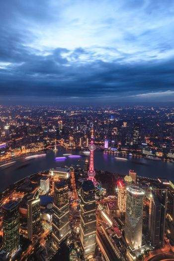 High Angle View Of Oriental Pearl Tower And Huangpu River In City At Dusk