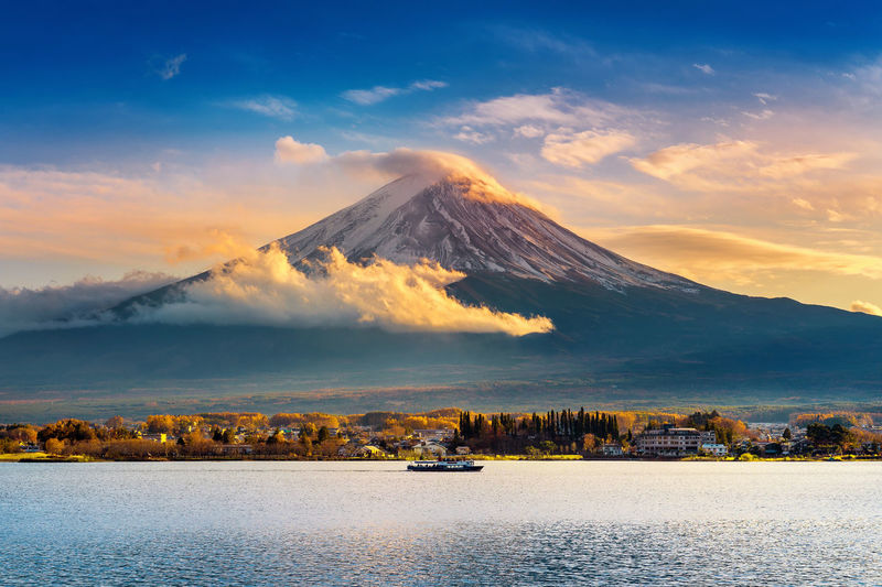 Fuji mountain and Kawaguchiko lake at sunset, Autumn seasons Fuji mountain at yamanachi in Japan. Architecture Beauty In Nature Cloud - Sky Day Landscape Mountain Mountain Range Nature No People Outdoors Scenics Sky Tranquil Scene Tranquility Water Waterfront