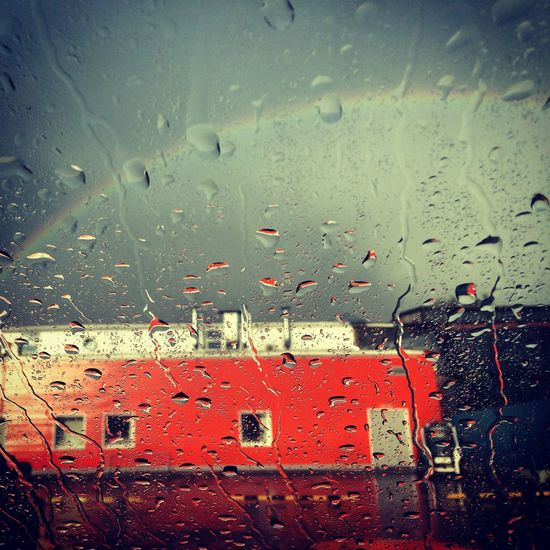 Drop Focus On Foreground Full Frame Glass - Material Indoors  Journey Mode Of Transport No People Rain Rainbow RainDrop Red Season  Sky Transparent Transportation Water Weather Wet Window
