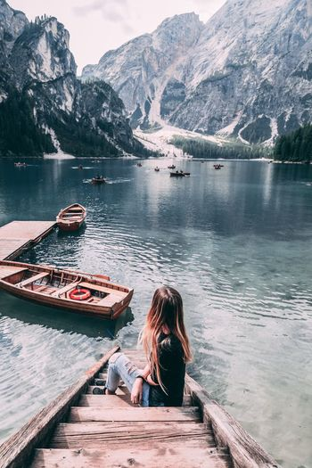 Water Mountain Beauty In Nature Women Adult Lake Leisure Activity Nautical Vessel Sitting Transportation One Person Nature Rear View Scenics - Nature Real People Day Lifestyles Mountain Range Outdoors