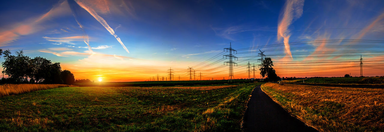 Der heutige Sonnenuntergang © #Marcin_Adrian https://www.marcinadrian.de Panorama Sonnenuntergang Beauty In Nature Cloud - Sky Electricity  Electricity Pylon Environment Field Grass Land Landscape Nature No People Outdoors Plant Power Supply Rural Scene Scenics - Nature Sky Street Sun Sunlight Sunset Tranquil Scene Tranquility