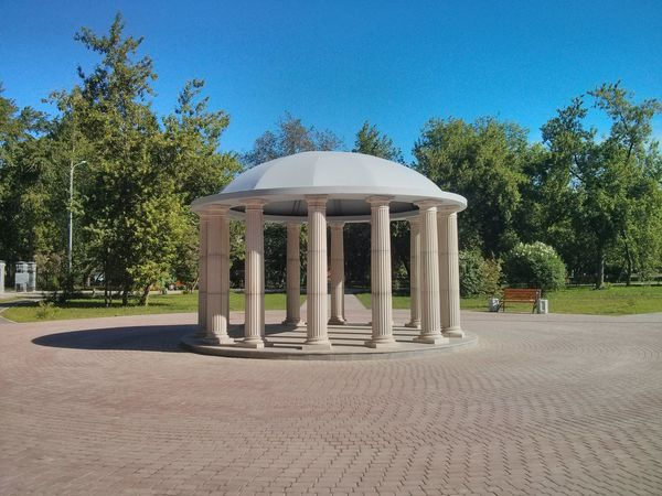Rotunda Architecture Blue Built Structure Clear Sky Day Grass Green Color Growth Nature No People Outdoors Park - Man Made Space Shadow Sky Sunlight Tree