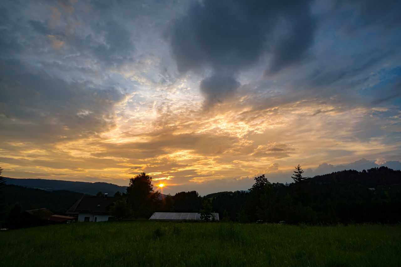 sunset, sky, cloud - sky, beauty in nature, scenics - nature, plant, orange color, nature, landscape, tranquil scene, no people, field, tranquility, environment, land, built structure, tree, architecture, idyllic, non-urban scene, outdoors
