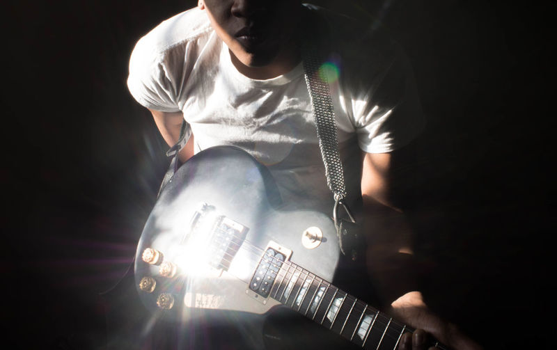 EyeEmNewHere Reflection Sunlight Guitar Illuminated Light And Shadow One Person Standing