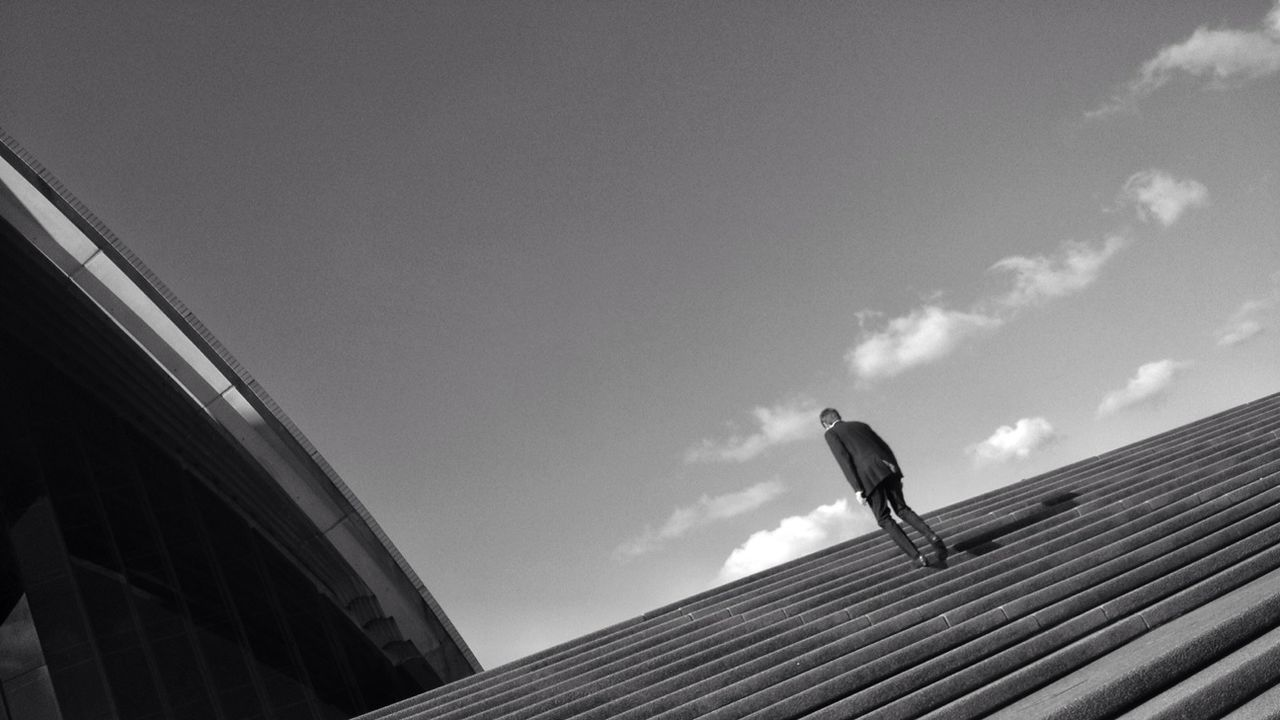 Low angle view of man walking upstairs