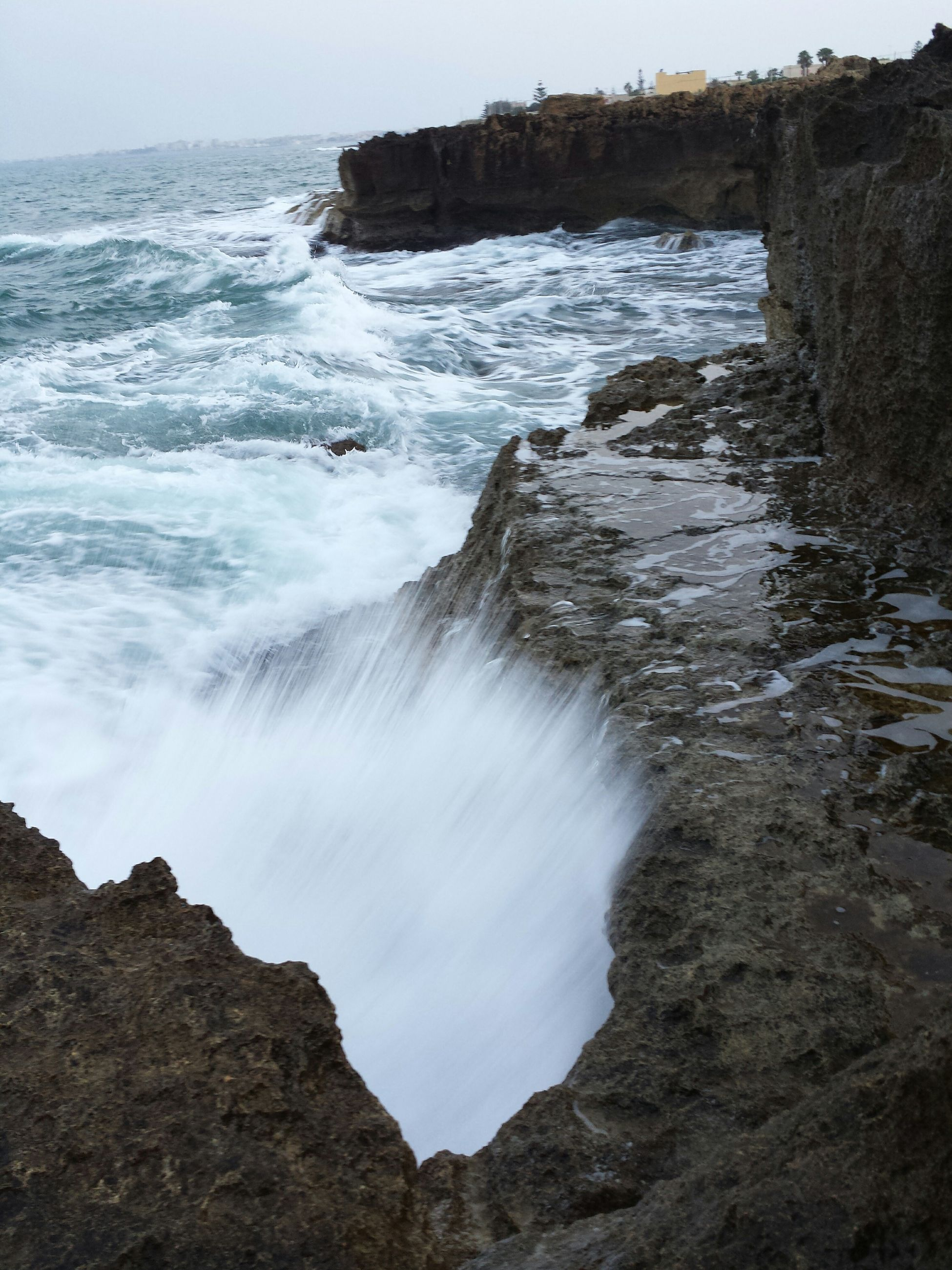 water, sea, surf, scenics, beauty in nature, rock - object, wave, rock formation, nature, tranquil scene, shore, motion, tranquility, beach, horizon over water, rock, splashing, idyllic, coastline, power in nature