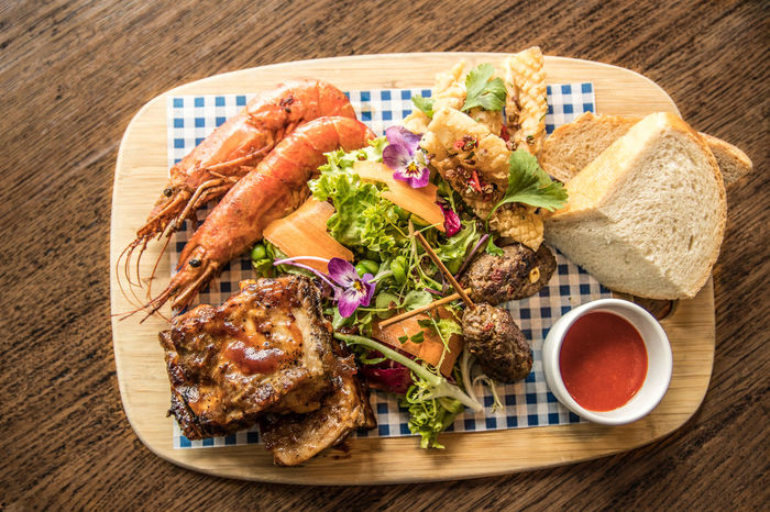 Pork Belly, Squid, Prawns and Salad Board Bread Food Sharing Fresh Fresh Food Good Food Green Color Home Cooking Micro Herbs No Plate Platter Pork Belly Prawns Restaurant Salad Share Squid Summer Food Table Setting