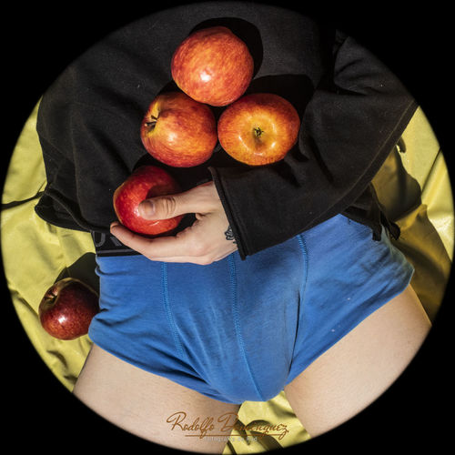 High angle view of man holding apple