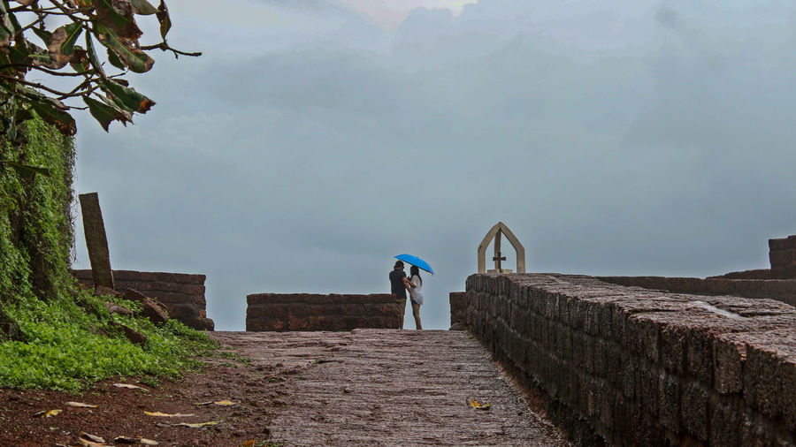 Monsoon Outdoors Standing Nature Real People Travel Destinations Clear Sky Looking At View Lifestyles Beauty In Nature Monsoon Diaries Monsoon Clouds Couple Photography Couple - Relationship Couple Goa India Goadiaries