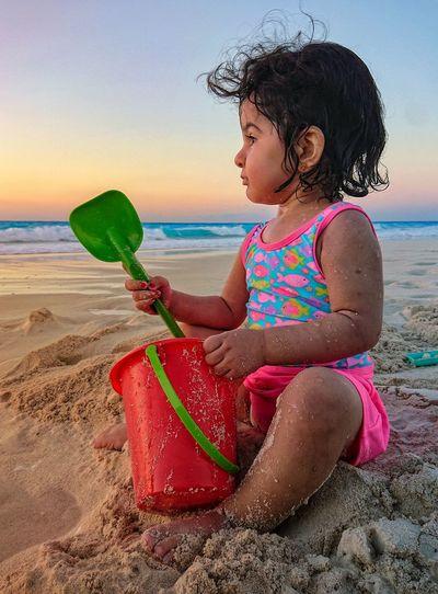 Fun Playing Girl Baby Bucket Shovel Sand Castle Vacation Sunset Water Child Sea Smiling Beach Sunset Childhood Sand Girls Summer Flamingo Seascape