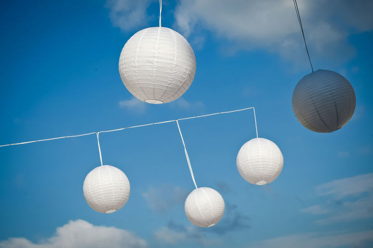 Sphere Hanging Sky No People Decoration Lighting Equipment Ball Blue Outdoors Day Lantern Celebration White Color Cable Motion Cloud - Sky Paper Lantern Light Wedding Wedding Decoration White Decorations Balls Wind Windy Five