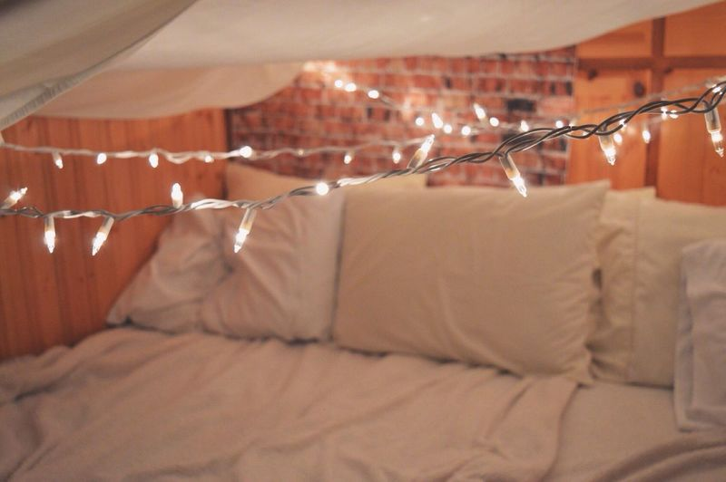 Illuminated String Lights Over Bed At Home