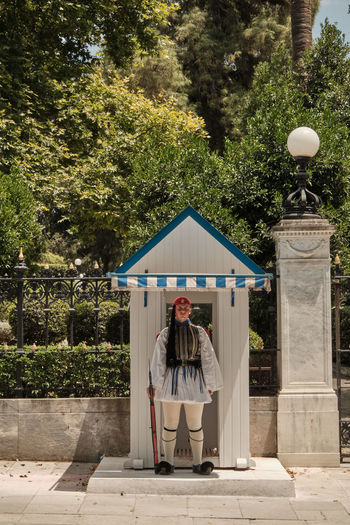 Mediterranean  Attica Patriotism Historic Marching Gun City Memory Uniform Greece Rifle Tourist Travel Landmark Touristic Soldier Greek Man Part Europe Town Kilt Culture Ceremony Government Tourism Political Athens Show Parliament National Square Legs Hellenic Red Costume Ceremonial Traditional Guard Weapon Capital person Body Honor