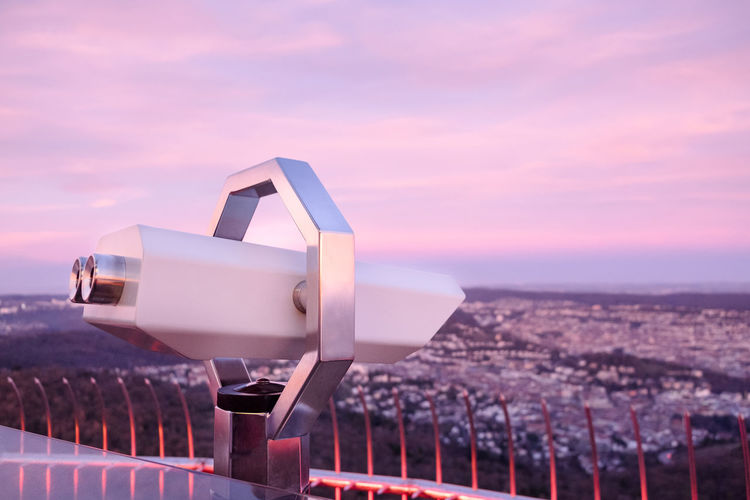 Touristic telescope looking at the city of Stuttgart, Germany from high up on the Television Tower at sunrise EyeEmNewHere Fernsehturm Stuttgart TV Tower View Day Fernsehturm / Tv Tower Nature No People Outdoors Sea Sky Stuttgarter Fernsehturm Sunrise Sunset Technology Telescope Touristic Telescope View From Above