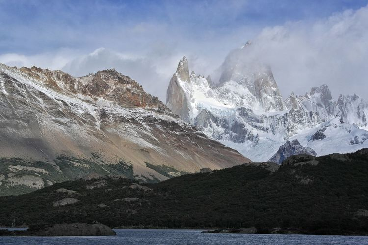 Cold summer morning at laguna capri. Fitzroy and Poincenot mountain rising in the background Mountain Mountain Range Landscape Mountain Peak Snow Outdoors Southamerica Lake Travel Destinations Patagonia Beauty In Nature Nature Cloud - Sky Scenics First Eyeem Photo Losglaciares Fitzroy Andes Mountains Shades Of Winter This Is Latin America The Traveler - 2018 EyeEm Awards The Great Outdoors - 2018 EyeEm Awards