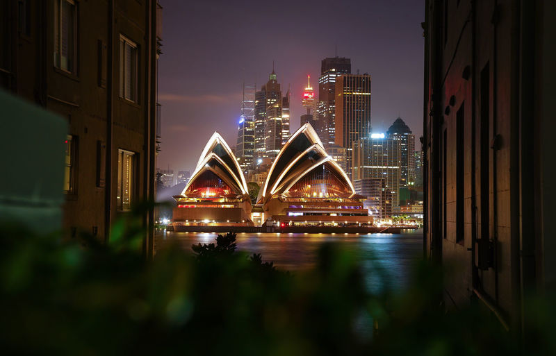 Opera House illuminated by lights at twilight sunset time Light Night Shooting Opera House Sydney Architecture Building Building Exterior Built Structure City Cityscape Connection Financial District  Iconic Landmark Iconic Landmark Of Sydney Illuminated Landmark Nature Night No People Office Building Exterior Sky Skyscraper Transportation Travel Destinations Twilight Sky Waterfront
