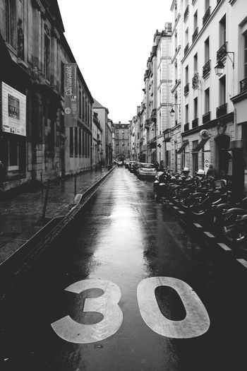 Rainy Day in Paris... Streetphotography Street Photography Streetphoto_bw Urban Exploration Urban Geometry Urban Landscape Capture The Moment From My Point Of View Learn & Shoot: Balancing Elements Showcase April Le Marais Walking Around Travel Travel Photography After The Rain Wet Day Black And White Monochrome Monochrome Photography