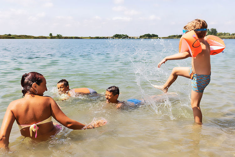 Group of people enjoying in water