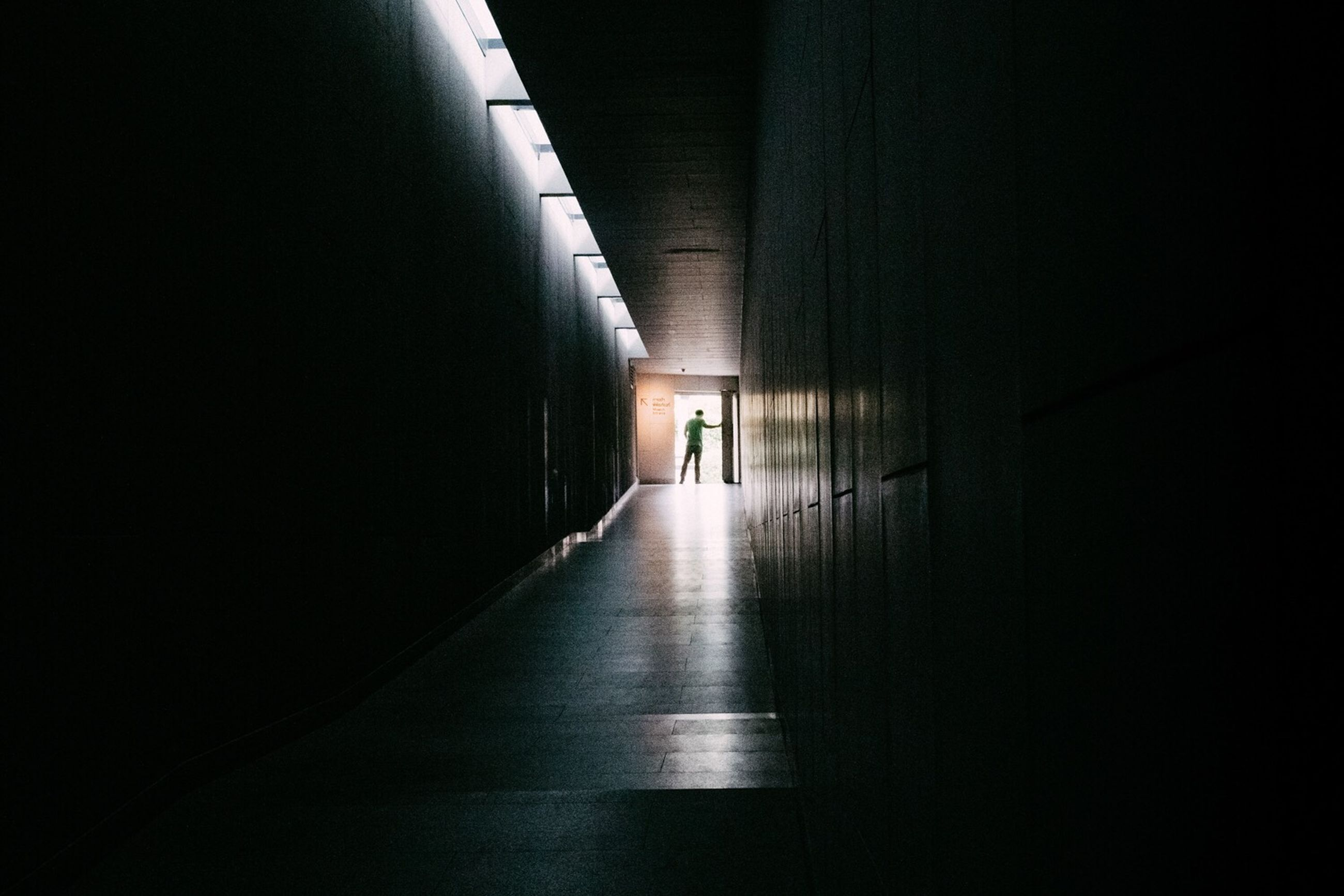 direction, the way forward, architecture, indoors, arcade, corridor, illuminated, built structure, building, tunnel, wall - building feature, empty, dark, lighting equipment, copy space, no people, entrance, diminishing perspective, flooring, wall, light at the end of the tunnel, ceiling, underpass