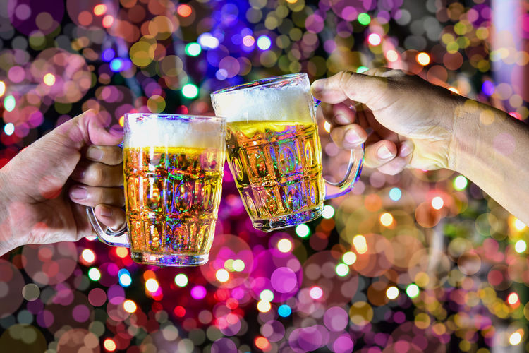 Alcohol Body Part Celebration Celebratory Toast Close-up Drink Drinking Glass Finger Focus On Foreground Food And Drink Glass Hand Holding Household Equipment Human Body Part Human Hand Illuminated Leisure Activity Lifestyles People Real People Refreshment