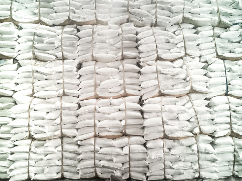 Stock of sugar in bags are storage in warehouse Logistics Warehouse Container Freight Transportation Lift Sugar Stacking Shipping  Business Finance And Industry Rice Import Starch Factory Trade Nature Export Handling Equipment White stuffing Close-up Full Frame Backgrounds Pattern Textured  No People