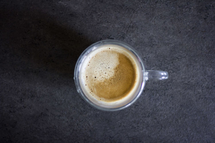 High angle view of coffee cup against black background