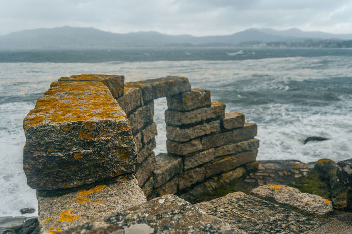 Baiona Galicia SPAIN Beauty In Nature Close-up Day Groyne Liquen Material Mountain Nature No People Outdoors Rock - Object Scenics Sea Sea And Sky Sky Stone Stones Tranquil Scene Tranquility Water