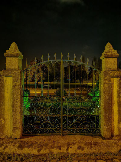 View of gate at night