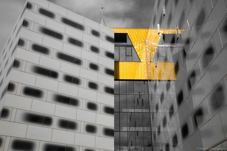 Glowing reflection Mirror Reflection Glass Architecture Blackandwhite Bnw Colour Colorsplash Architecture Building Exterior Built Structure Yellow Modern City Office Building Exterior Apartment Skyscraper Sky No People Day Outdoors Low Angle View The Graphic City EyeEmNewHere