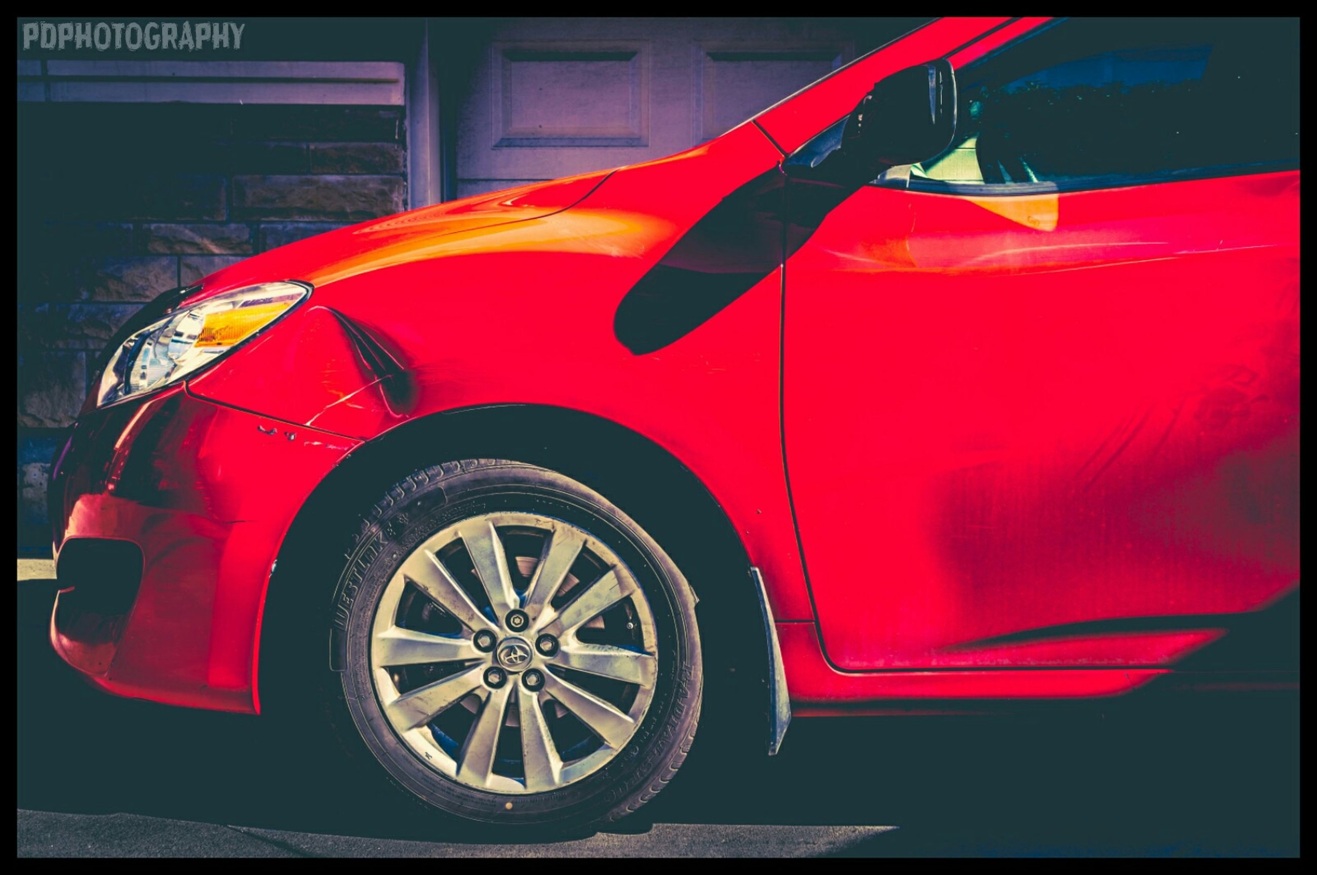 transportation, mode of transport, land vehicle, transfer print, red, stationary, auto post production filter, car, wheel, parking, bicycle, parked, travel, no people, street, day, tire, outdoors, vintage car, close-up
