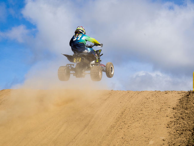 Competition Competitive Sport Crash Helmet Danger Day Extreme Sports Full Length Helmet Jumping Low Angle View Mid-air Motion Motocross Motorcycle Motorsport One Person Outdoors Real People RISK Sand Dune Skill  Sky Speed Sport Sports Race