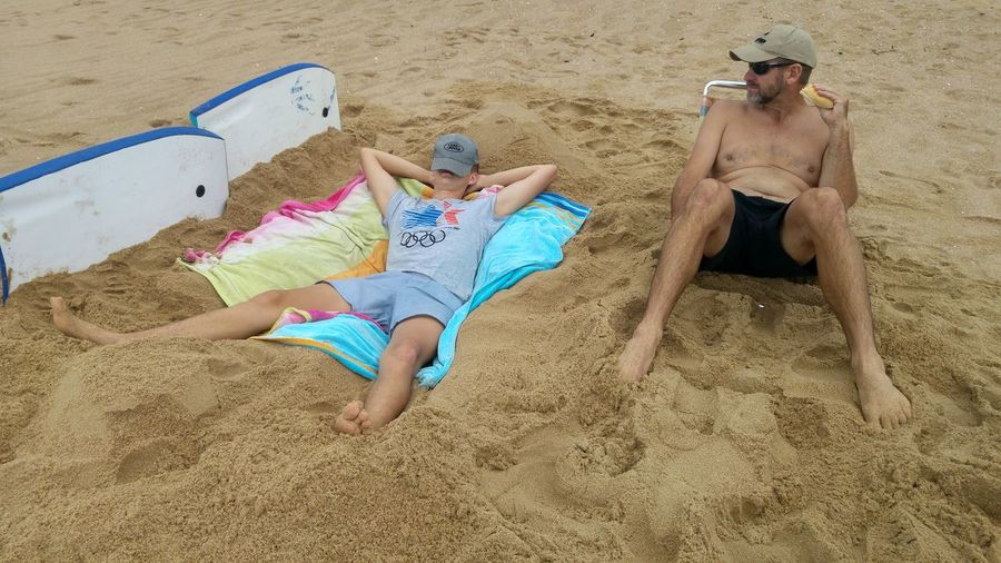 High angle view of men sitting on beach