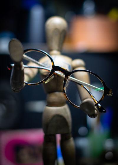 Close-up of eyeglasses on figurine